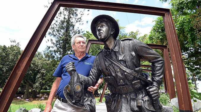 CENTENARY: Vice President of Queens Park Military Trail Greig Bolderrow with The Wounded Soldier.