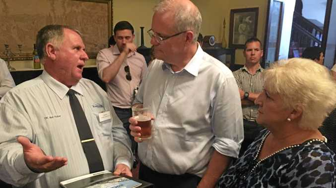 SALES PITCH: Councillor Neil Fisher speaks to Prime Minister Scott Morrison about the Rockhampton Airport at Politics in the Pub at the Criterion Hotel on Tuesday.