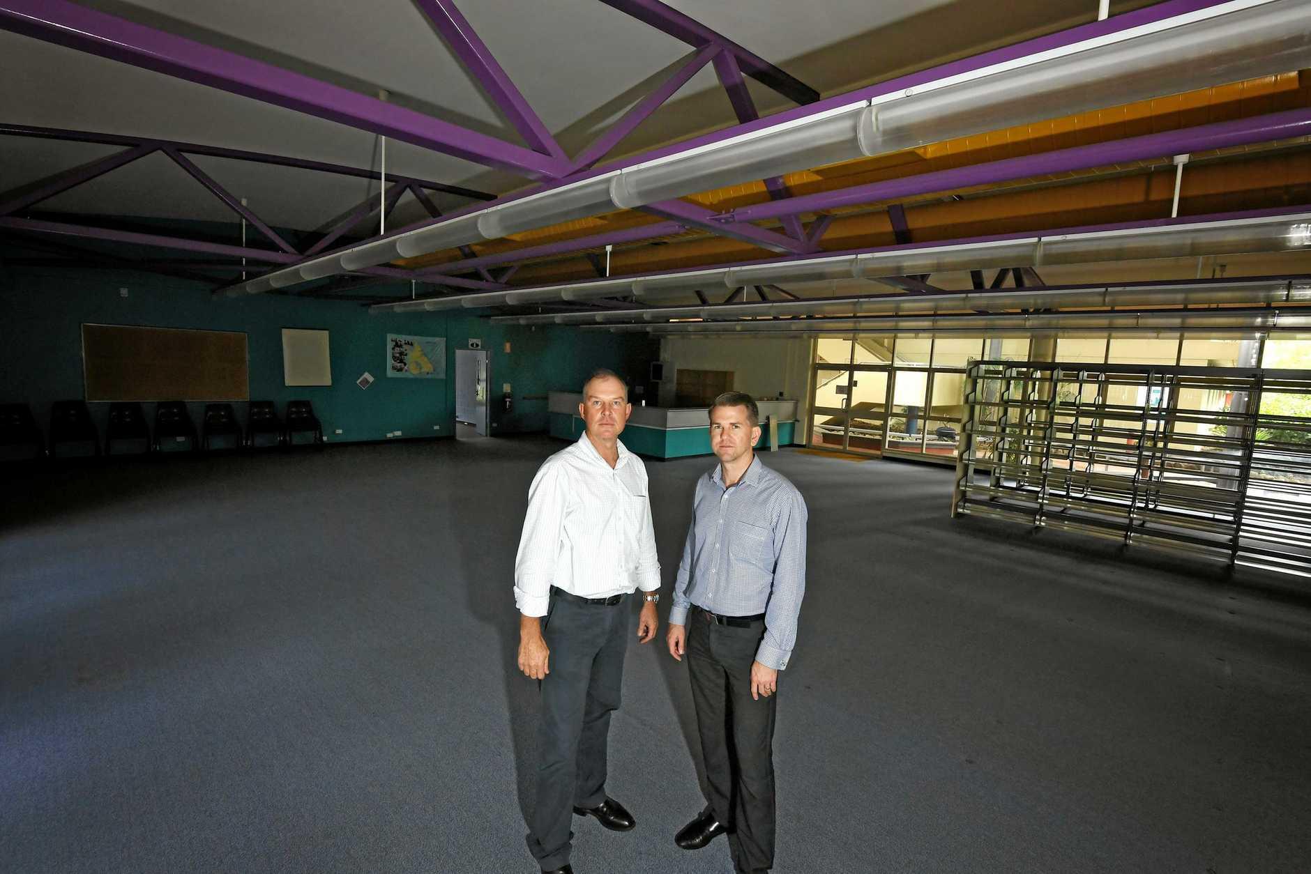 Tony Perrett and Jarrod Bleijie inside the empty TAFE building.
