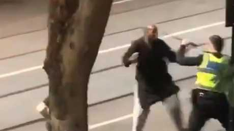 Video shows the man attacking police before he is shot. Picture: Twitter