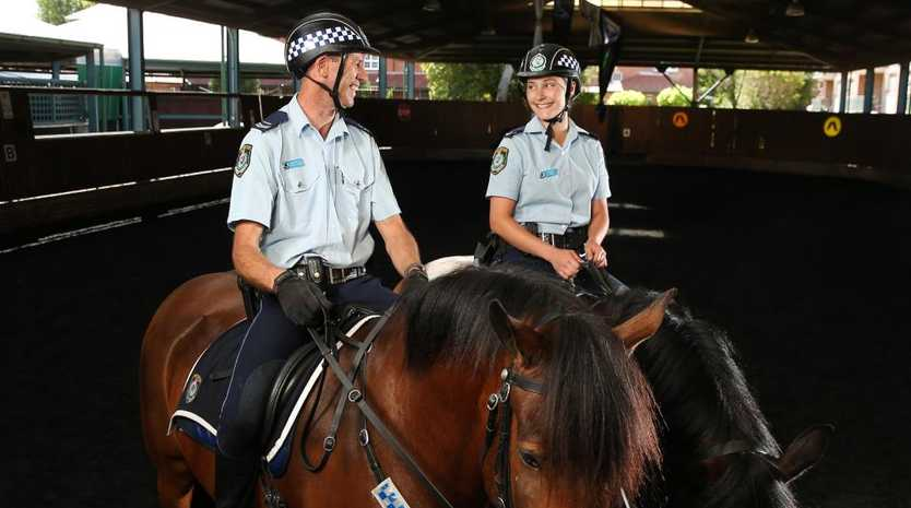 Mounted police Patrick Condon and Chloe Green work on training Prince and Angus. Picture: Richard Dobson