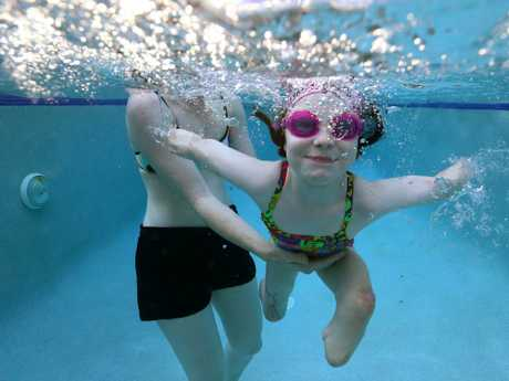 Mia leads as normal a life as possible and loves swimming. Picture: Adam Head