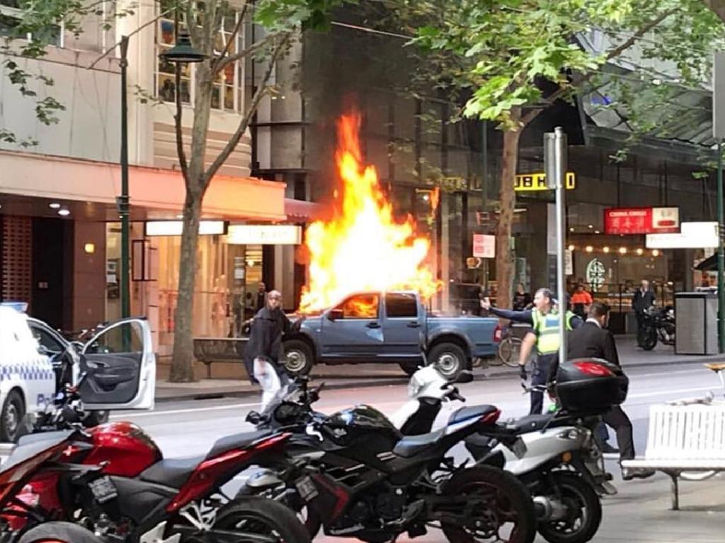 A 4WD ablaze on Bourke St. Picture: Chris Macheras