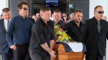 Brent Moloney and Colin Sylvia's father, Craig, lead the pallbearers out of the service. Picture: Jay Town
