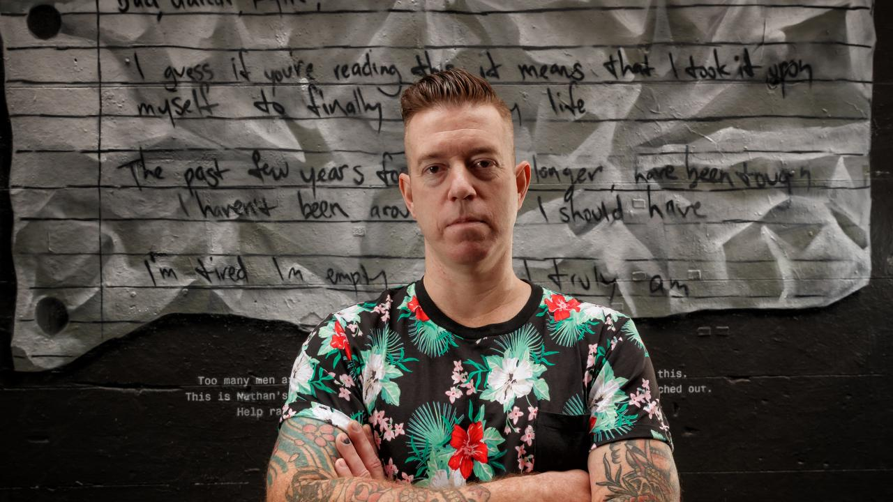 Mo Bro and mental health advocate Nathan Tomlin in front of his suicide note artwork in Hosier Lane. Note: The artwork was developed in consultation with the mental health and suicide prevention sector. Picture: AAP