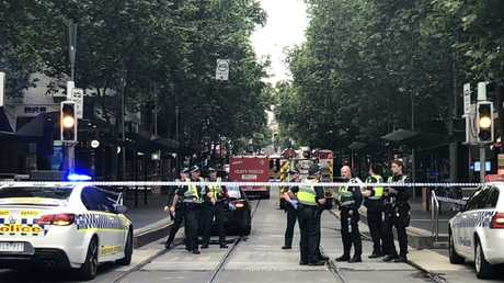 Police cordon off Bourke St after a car explosion. Picture: Aneeka Simonis