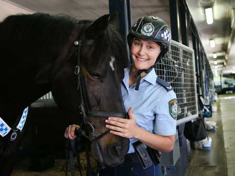 Chloe Green pictured with Angus at the Mounted Police stables in Redfern. Picture: Richard Dobson