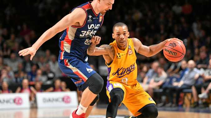 Anthony Drmic of the Adelaide 36ers and Jerome Randle of the Sydney Kings tussle at Titanium Security Arena on Saturday.  Picture: David Mariuz/AAP
