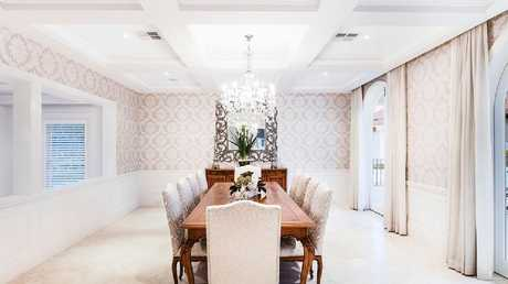 The decadent dining room in the home.