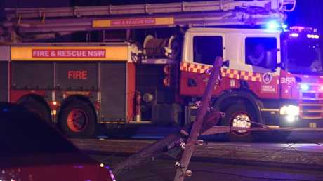 A car had collided with a bus stop, then hit a power pole bringing the power pole and power lines down across Canterbury Road. Picture: Gordon McComiskie