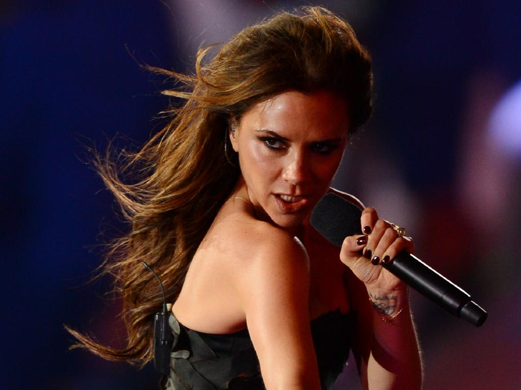 Victoria Beckham spices it up during the Spice Girls' triumphant return during the London 2012 Olympic Games. Picture: Mike Hewitt/Getty Images