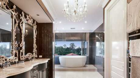 One of the bathrooms in the property at 121 King Arthur Tce, Tennyson.