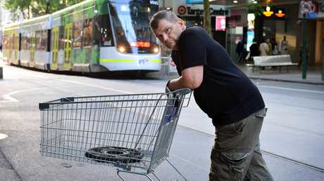 A shy and humble Mr Rogers didn't want to comment further when approached by the Sunday Herald Sun but agreed to pose for this photo with the trolley he used to fend off a terrorist. Picture: Nicki Connolly.