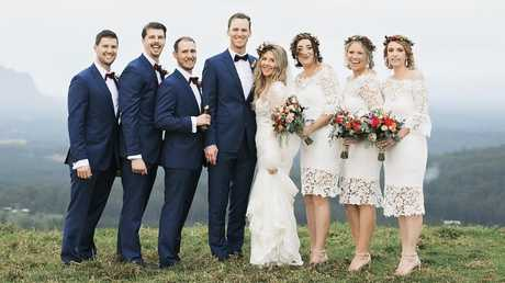 Jennifer Elliott and Troy Dyer with their bridal party.