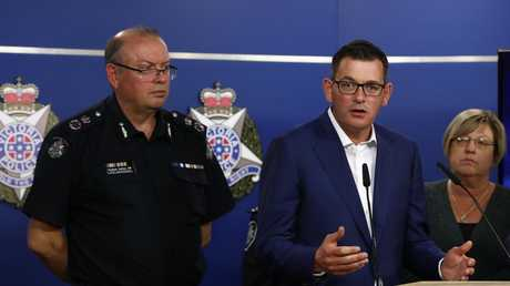 Victoria's Premier Daniel Andrews speaks to the media as CCP Graham Ashton listens on. Picture: Robert Cianflone/Getty Images