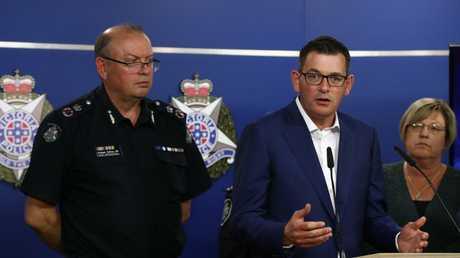 Victoria's Premier Daniel Andrews speaks to the media as CCP Graham Ashton listens on. Picture: Robert Cianflone/Getty Images
