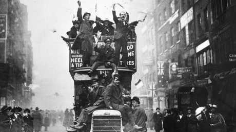 Crowds celebrating the signing of the Armistice at the end of World War I. (Photo by Topical Press Agency/Getty Images) Picture: Images Getty