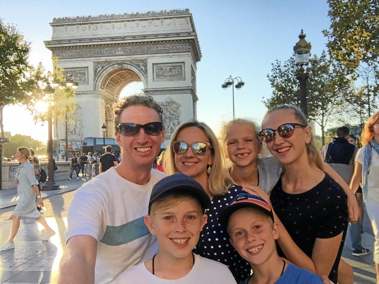 The Nicholl family at the Arc de Triomphe in Paris, France. From left to right is Nathan, Amaya (8), Kalia (16) and Beth. Front is Tide (12) and Rase (10).