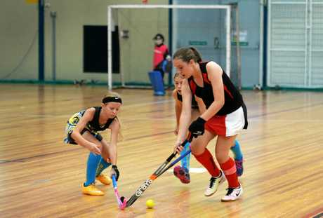 Amy Woods from Rockhampton Black playing in the Under 13 Indoor Hockey State Team Challenge at CQUniversity.