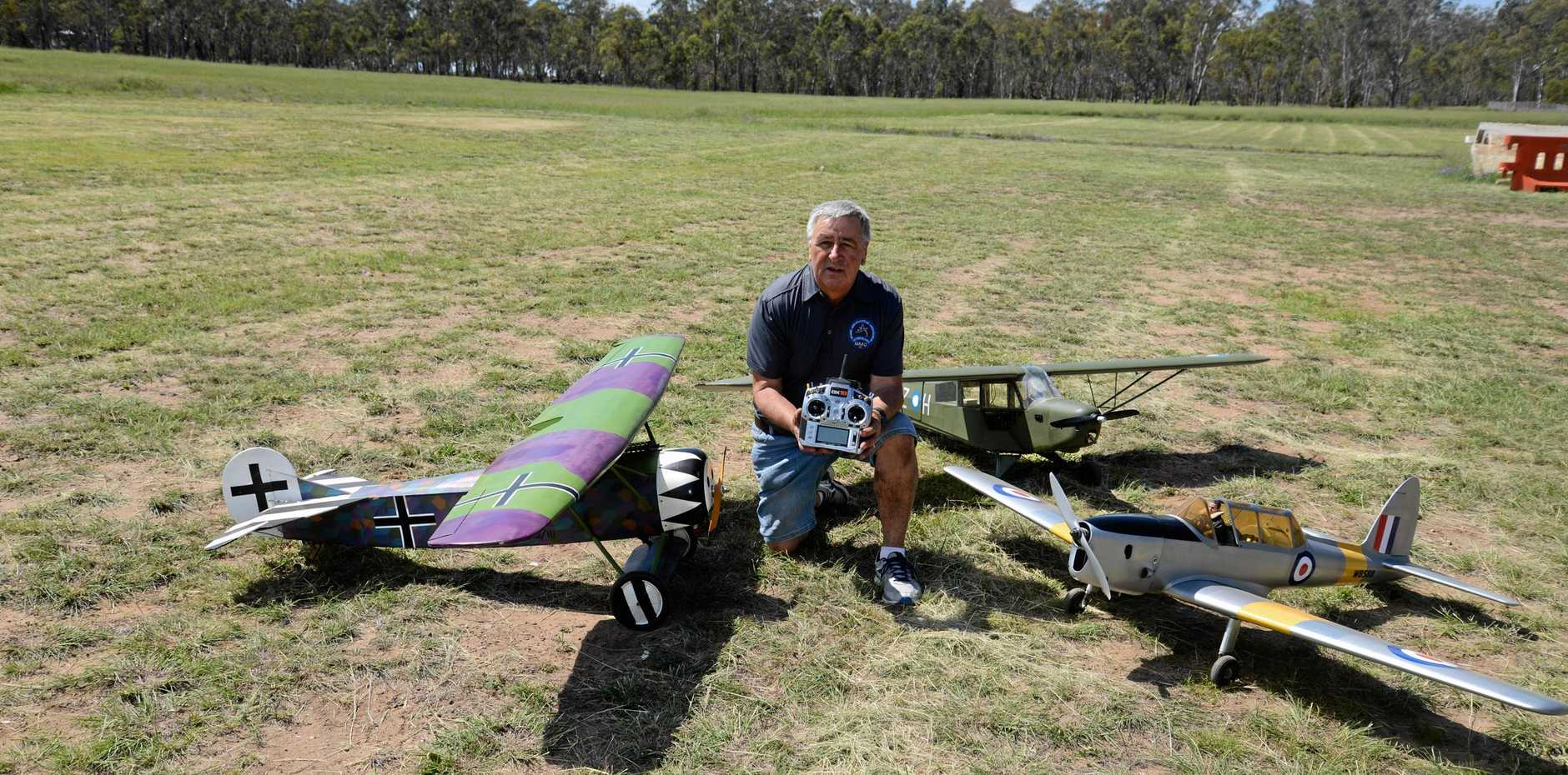 Caboolture pilot Warren Hathaway with three Warbirds on Remembrance Day at the Warwick Aero Modellers Club  at Morgan Park.