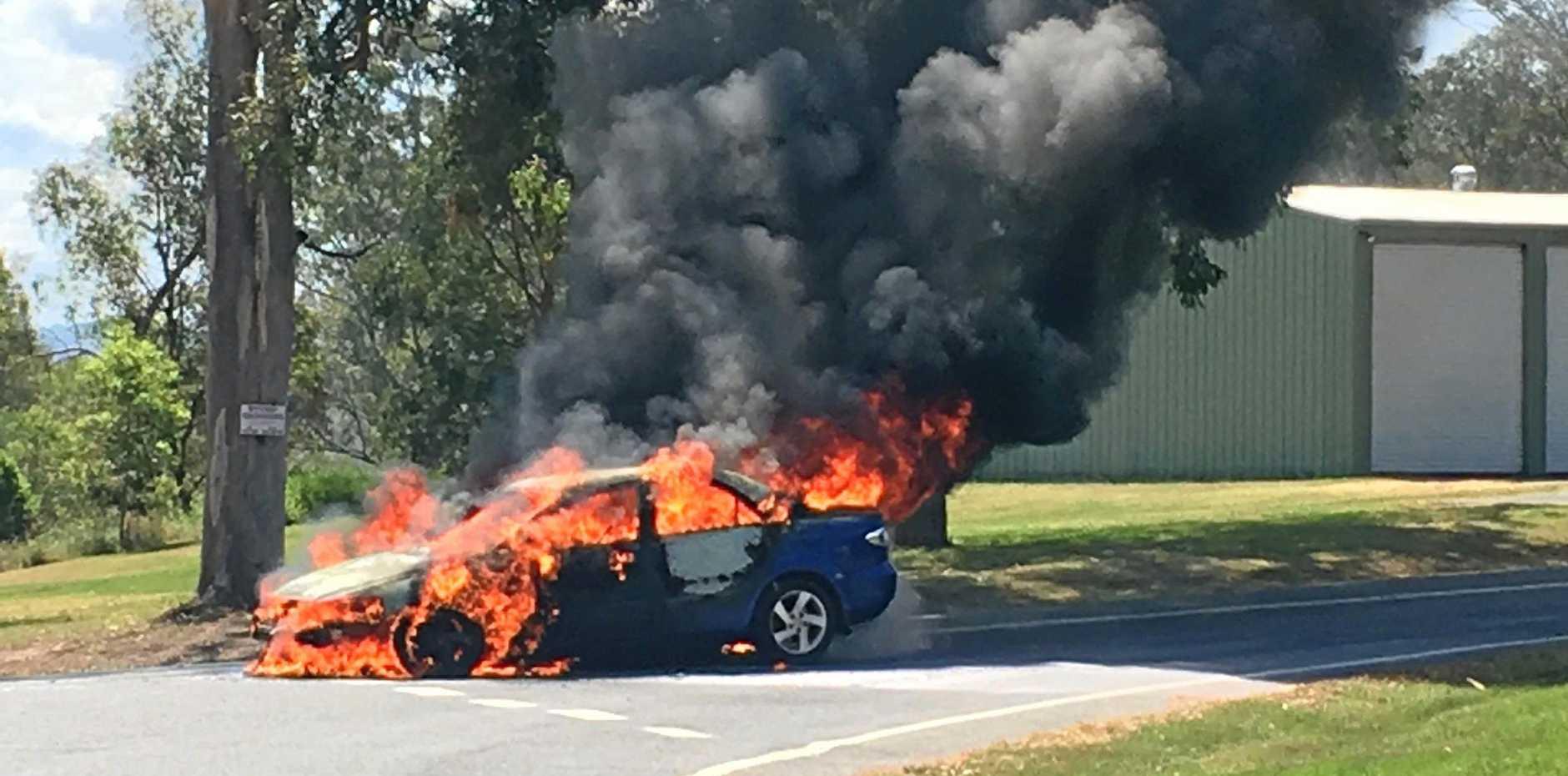 A car burns at Pie Creek