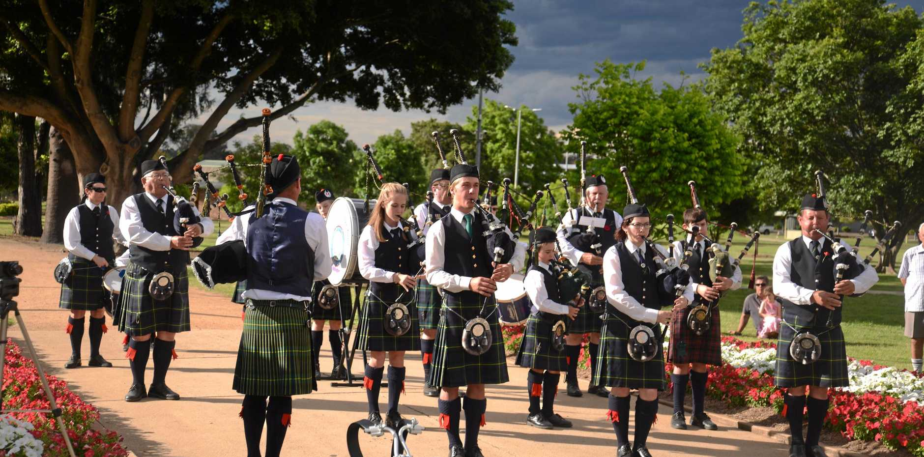The Warwick Thistle Pipe Band performs on Sunday afternoon in Leslie Park.