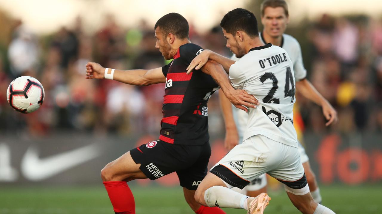 Brisbane Roar's Connor O'Toole competes with Jaushua Sotirio of Western Sydney Wanderers on Saturday. Picture: AAP