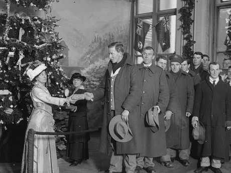 December 1915: Australian soldiers receiving gifts from the Christmas tree at an ANZAC's  buffet. Picture: Topical Press Agency/Getty Images