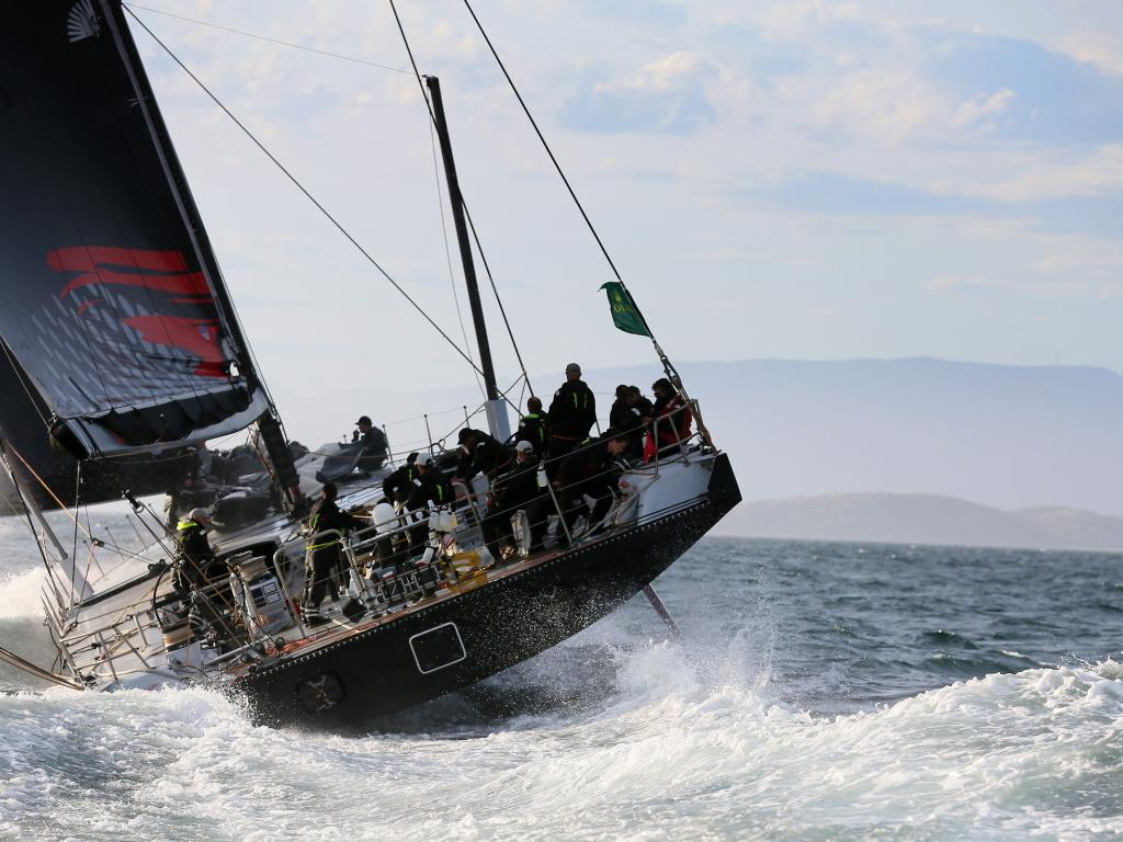 Comanche sails across Storm Bay towards Hobart in last year's race. Picture: Richard Jupe