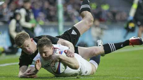 England's Chris Ashton scores a try at Twickenham in London.