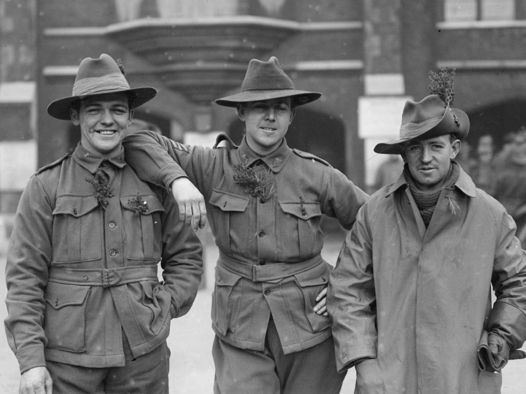 January 1916: Australian troops in Britain wearing the 'wattle', a type of acacia and the national emblem of Australia. Picture: Topical Press Agency/Getty Images