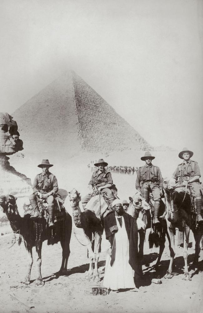 Australian infantrymen riding camels near the Sphinx, with the Great Pyramid of Giza in the background, circa 1915. Picture Paul Thompson/FPG/Getty Images