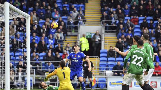 Brighton & Hove Albion goalkeeper Mathew Ryan saves Cardiff City's Callum Paterson's shot.