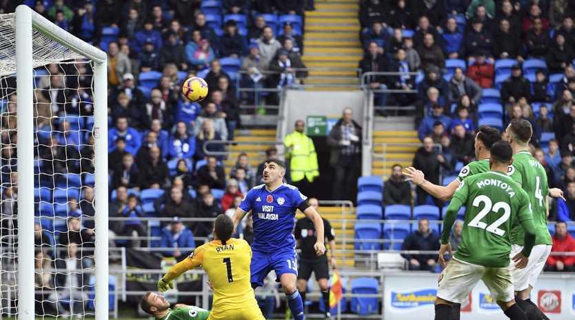 Brighton & Hove Albion goalkeeper Mathew Ryan saves Cardiff City's Callum Paterson's shot.