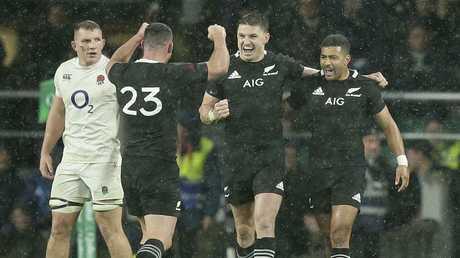New Zealand celebrate the 16-15 win over England at Twickenham.