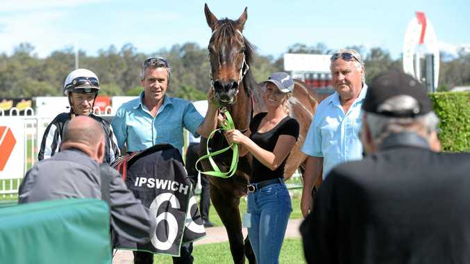 PLACE TO BE: Jockey Michael Cahill joins with connections after winning aboard Temujin's Moon at Ipswich racetrack.