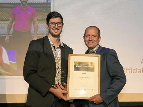 Official of the Year Aaron Gotting receives his award from Ipswich City Council representative Bryce Hines.