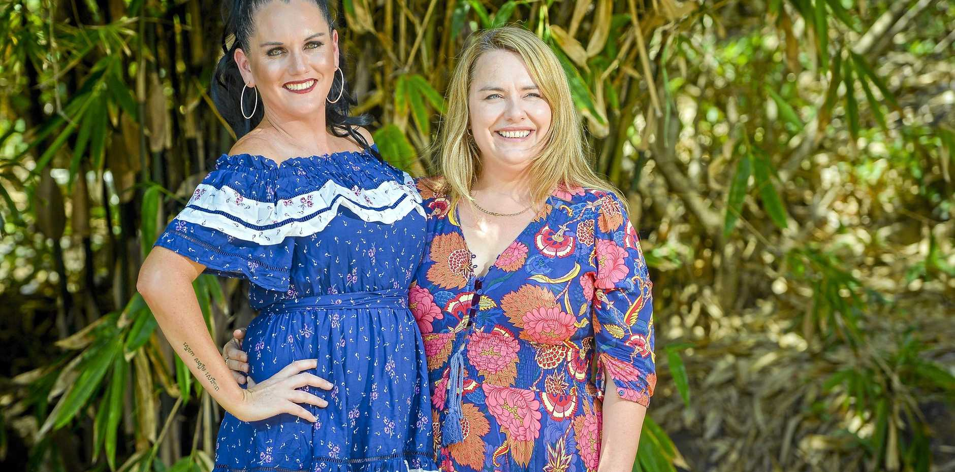 IN FASHION: Angelina Taylor (left) models clothing from Gladstone boutique Style House Fashion alongside manager Gabrielle Hockings.