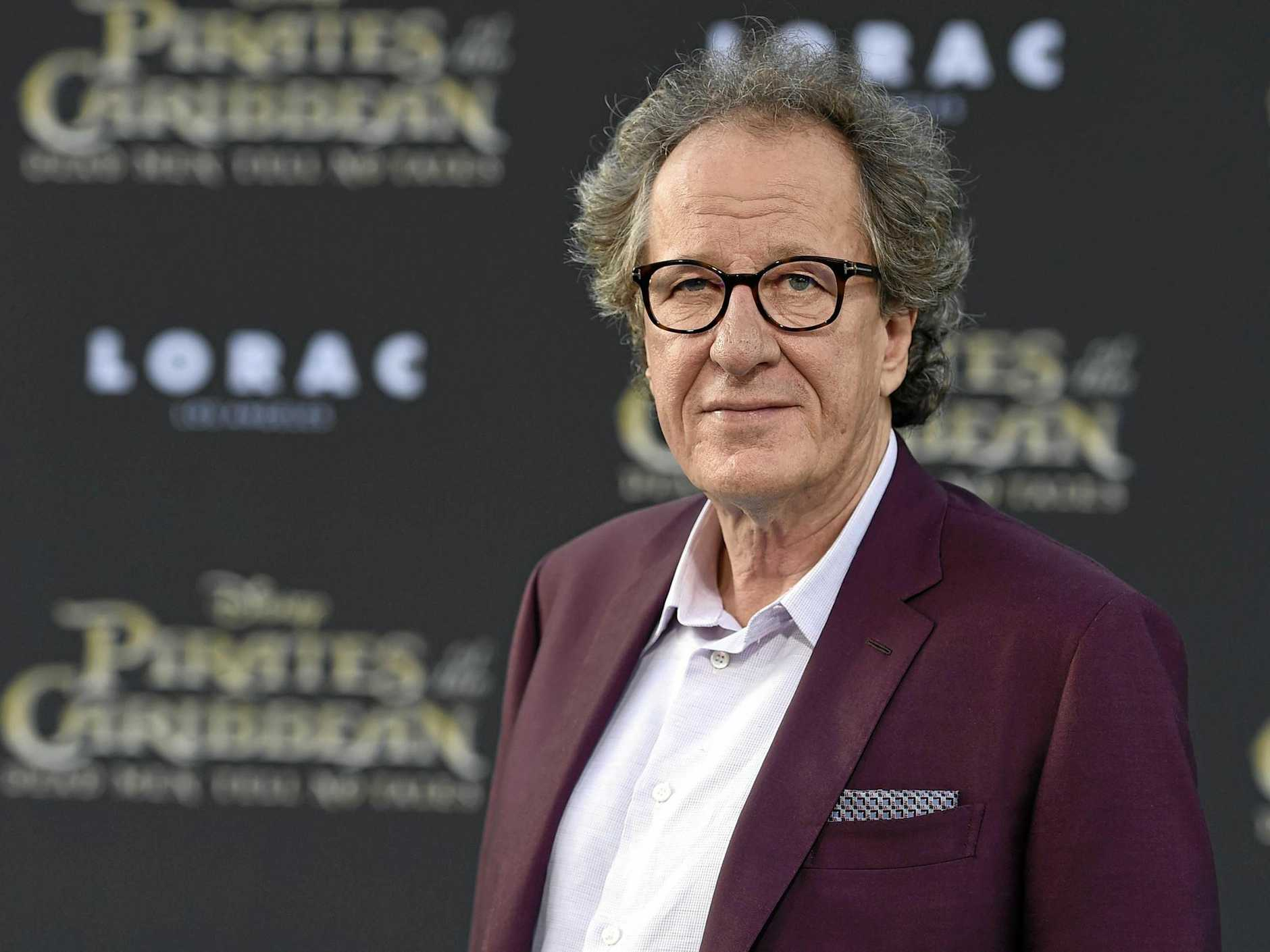 FILE - In this May 18, 2017 file photo, Geoffrey Rush arrives at the Los Angeles premiere of
