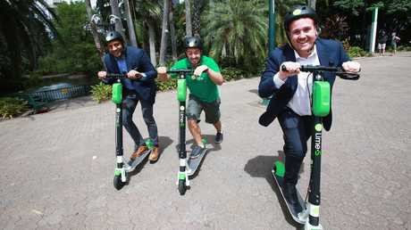 Mayank Mittal, Vinicius Machado Campos and Mitchell Price pose at Brisbane Botanical Gardens in Brisbane CBD. The team hope to launch LIME hire electric scooters in Brisbane. Picture: Claudia Baxter