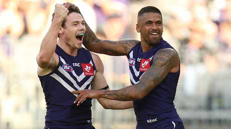 Lachie Neale celebrates a goal during his time in Fremantle.