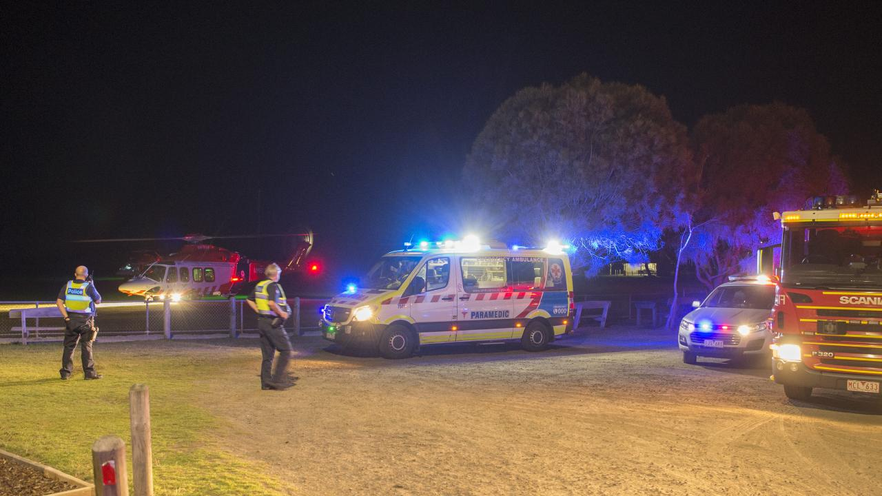 Paramedics and police at the scene. Picture: Alan Barber