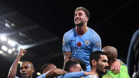 Ilkay Gundogan of Manchester City (2R) celebrates with Kyle Walker of Manchester City (C) and teammates after scoring