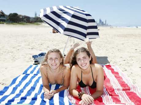 Mirren Alford, 20, from Logan Village (left) and Savannah Lee, 18 from Coomera enjoy the gorgeous weather at Mermaid Beach. Pic Tim Marsden