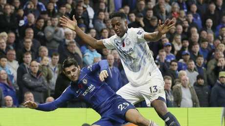 Chelsea's Alvaro Morata, left, duels for the ball with Everton's Yerry Mina