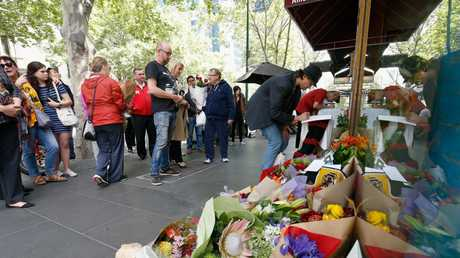 Mourners have been laying floral tributes at the iconic Melbourne cafe, Pellegrinis. Picture: Darrian Traynor/Getty Images