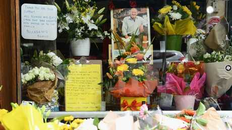 Flowers left out the front of Pellegrini's Espresso Bar after co-owner Sisto Malaspina's death. Picture: Quinn Rooney/Getty Images.