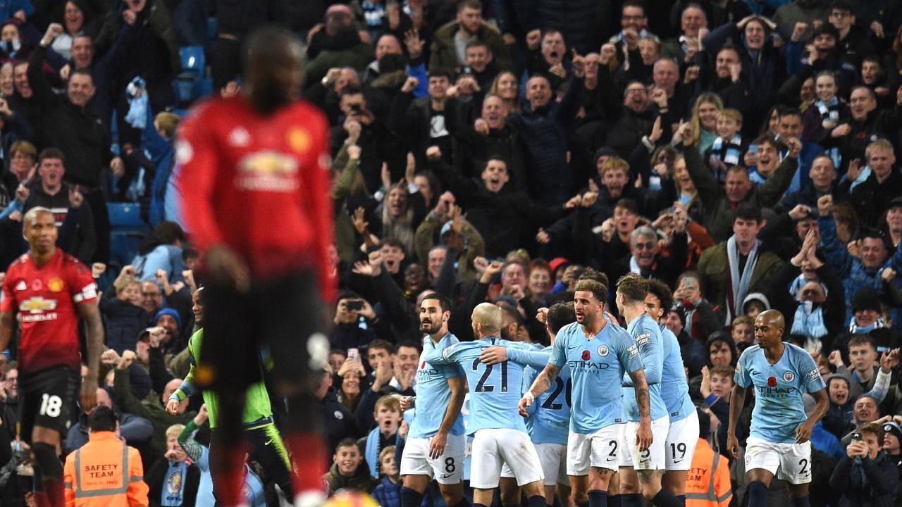 Manchester City's German midfielder Ilkay Gundogan celebrates with teammates