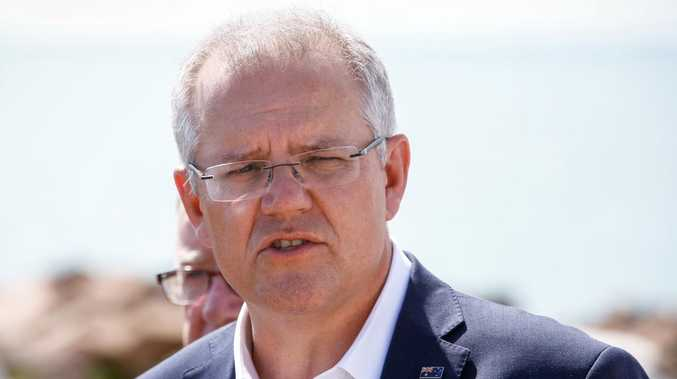 Australian Prime Minister Scott Morrison had a long chuckle before cracking a joke at Pamela Anderson's expense. Picture: AAP/Michael Chambers