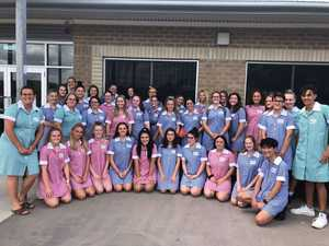 Mackay Northern Beaches SHS students wearing dresses